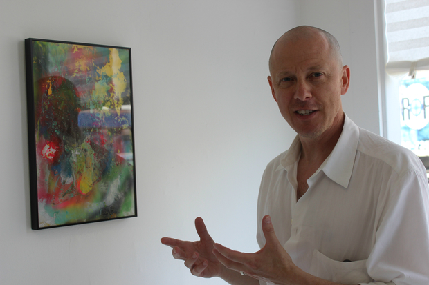 Jason Pickleman, 50, explaining the idea behind Maxwell Graham's artwork at his new gallery, 4755 N. Clark St.