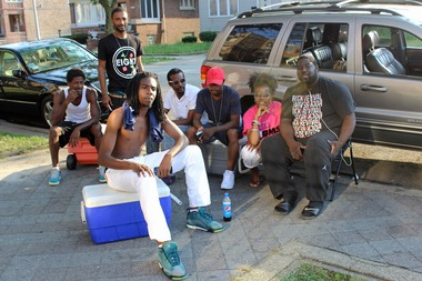 Tamar Manasseh, who founded Mothers Against Senseless Killings, sits with other volunteers keeping an eye on the neighborhood since a murder on June 23. The group's organizer said she needs more help.