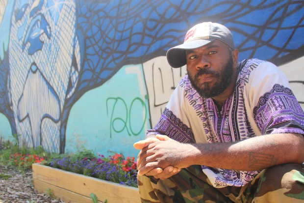 Tony Collins, an artist on the block, painted a mural on the vacant building next to the lot, he said.