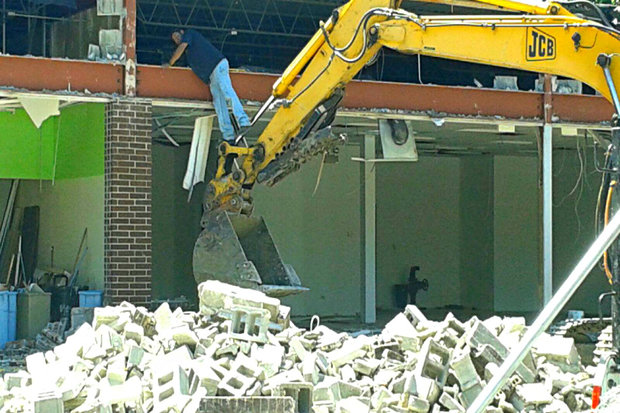 Crews were demolishing existing storefronts at 1313 W. Morse Ave. Monday.