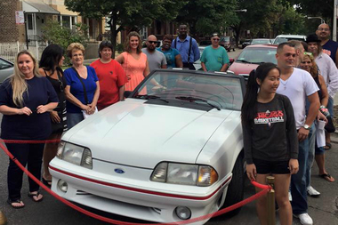 Jennifer Nadwodney (l.) was the lucky winner of a 1990 Ford Mustang, given away by Fabulous Freddies, which celebrated 25 years in Bridgeport this month.