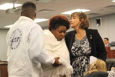 Ald. Susan Sadlowski Garza (r.) helps Dyett hunger striker Jeanette Ramann leave the Board of Education meeting, escorted by CPS security. Ramann collapsed into a chair on her way out.
