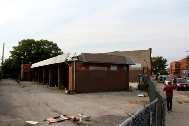 The shuttered car wash where the development is planned to replace.