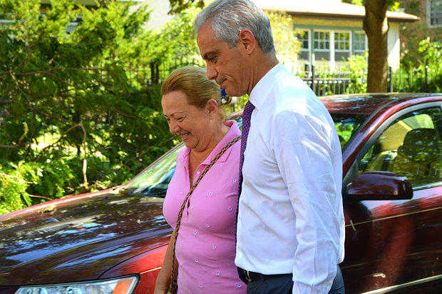 Mayor Rahm Emanuel met with neighbors in the Rogers Park community Monday morning to assess the damage left in the area from Sunday's storm.