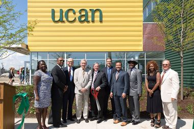 UCAN officials are seen celebrating the opening of its North Lawndale facility. From left: Nacole Millbrook, UCAN vice president of counseling; Bishop Derrick Fitzpatrick; George Frost, UCAN trustee; George Sheldon, acting director for Department of Children and Family Services; Rick Fleming, president of UCAN governing board; Zack Schrantz, UCAN president; Ald Michael Scott Jr, 24th Ward; Rep. Art Turner, D-9; Sylvia Davis, UCAN alumna; Tom VandenBerk, UCAN CEO.