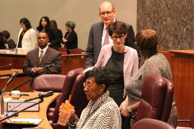 Ald. Carrie Austin (foreground), chairman of the Budget Committee, and Budget Director Alexandra Holt (pink cardigan) arrive for Monday's hearing.