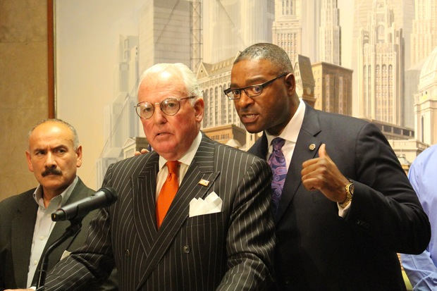 Cook County Commissioner Richard Boykin (right), seen with Aldermen Ariel Reboyras and Edward Burke, is pitching a new tax on Uber and Lyft.