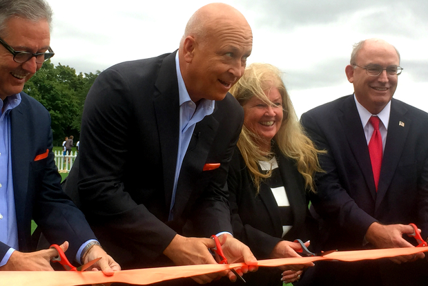 Major League Baseball Hall of Famer Cal Ripken Jr. cuts the ribbon at Freedom Field at Marquette Park which was donated by Cal Ripken Sr. Foundation.