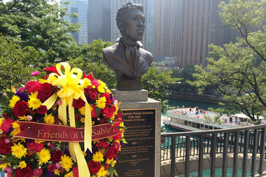 A wreath laid at the bust of Jean Baptiste Point DuSable at Pioneer Court (file photo)