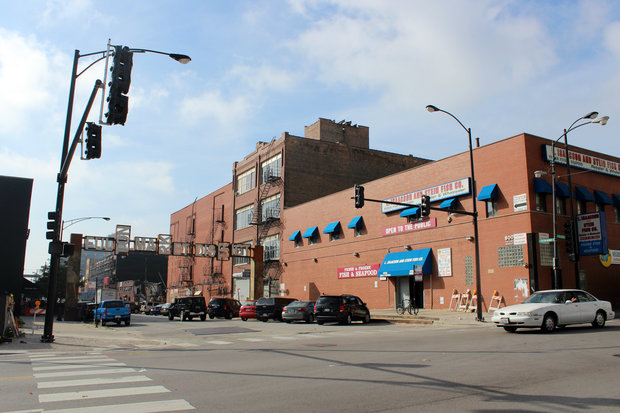 Traffic signals at the busy intersection at Fulton and Halsted streets were installed Friday.