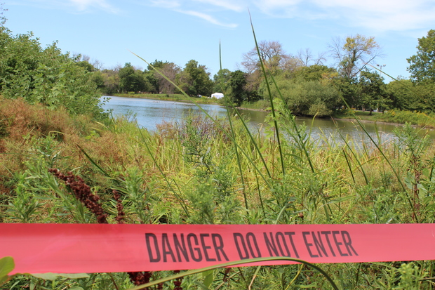 The lagoon was closed off as crews search for clues in the death investigation of a 2- or 3-year-old.