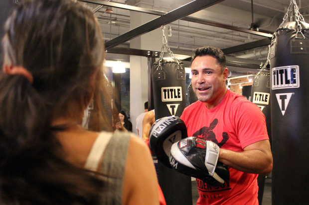 In Chicago to promote his new partnership with Estrella TV, world champion boxer Oscar De La Hoya dropped in on a class at TITLE Boxing Club in the West Loop Thursday.