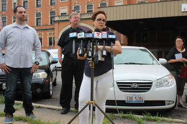Katheryn Grosso airs concerns on behalf of St. Anthony Hospital at a Monday press conference to criticize Riot Fest. Hospital employee Edgardo Reyes (far left) and the Rev. Larry Dowling (center) also gave brief remarks.