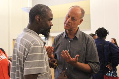 Whole Foods co-CEO Walter Robb, (r.), talks to Englewood residents.