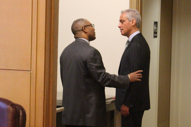 Ald. Walter Burnett Jr. and Mayor Rahm Emanuel talk in private before Wednesday's City Council meeting on the 2016 budget.
