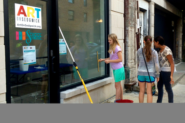 Volunteers help prep Art on Sedgwick for its opening day.