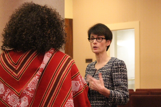Budget Director Alexandra Holt talks with a homeowner after Monday's hearing.
