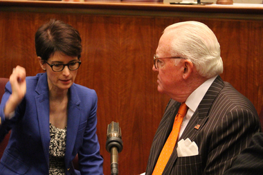 Budget Director Alexandra Holt and Ald. Edward Burke talk before Wednesday's Finance Committee meeting.