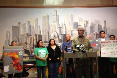 Diane Limas of Communities United speaks out against Mayor Rahm Emanuel's proposed property tax hike Tuesday at City Hall.