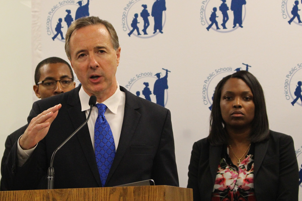 Chicago Public Schools CEO Forrest Claypool addresses the news media as Chief Education Officer Janice Jackson stands behind him in January.
