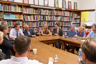 Mayor Rahm Emanuel discusses school overcrowding with Ebinger Elementary School parents, including 41st Ward Ald. Anthony Napolitano, at a September 2015 meeting at the school.