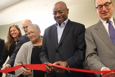 Ald. Willie Cochran (20th) joined former residents of Grove Parc Plaza like Margaret Brewer (l.) to open a new 65-unit senior building that pushed the unit count over 400 for the redevelopment of the former Section 8 housing.