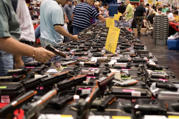 Buyers shop at a gun show in this file photo.