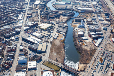 An aerial view of Gutmann Leather Tannery site and the other industrial sites along the Chicago River shows the since-razed Finkl Steel plant to the left and the city's Fleet Management lot in the upper right corner.