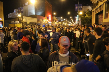 Cubs fans celebrate during the 2015 postseason in Wrigleyville.