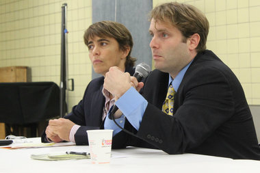 Ald. Deb Mell and Ben Winick, head of the independent budget office, listen to residents of the 33rd Ward at a budget town hall.