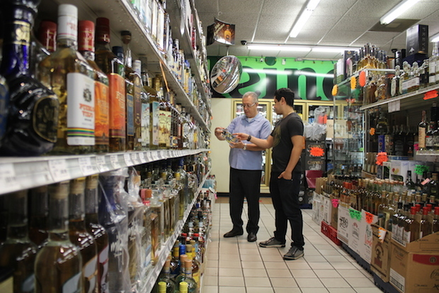 Michael Moreno, Sr. (left), and his son Michael Jr. have built one of the largest tequila collections in the country.