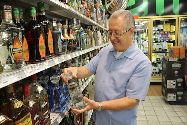 Michael Moreno Sr. examines one of his favorite tequilas.
