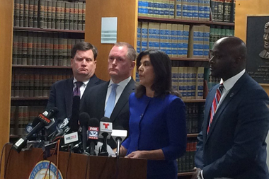 Cook County State's Attorney Anita Alvarez (second from right) said the shooting that killed 17-year-old Laquan McDonald was