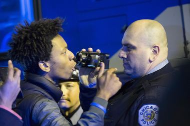 Protesters confront Chicago police officers Downtown after the video of Officer Jason Van Dyke shooting 17-year-old Laquan McDonald 16 times was released.