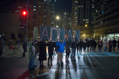 Protesters confront Chicago police officers Downtown Tuesday night after a video of Officer Jason Van Dyke shooting 17-year-old Laquan McDonald 16 times was released.