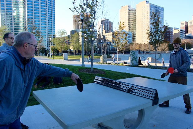 Grant Park visitors playing ping-pong at the new table Monday.