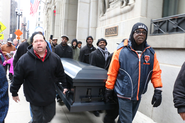 Activists carried a symbolic casket for Laquan McDonald during a march around City Hall on Saturday afternoon.