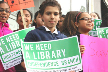 Supporters rallied for a permanent home for the Independence Library, closed following a fire in the adjacent building.