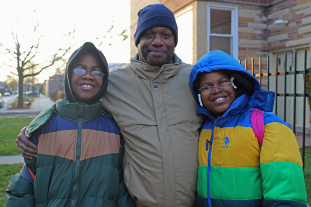 Joplin student Jarrell Driver (l.), his father Andre Garner and his  sister Taneva Driver outside the school Thursday.