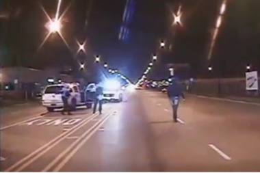 A still from the dashcam video of Laquan McDonald being shot by a police officer.