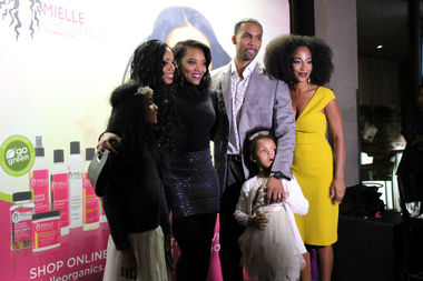 Monique Rodriguez, owner and founder of Mielle Organics, poses with her family and Yandy Smith (second from left), Mielle's first celebrity ambassador and cast member on VH1's Love & Hip Hop, during a celebration at Deuce's & The Diamond Club in Wrigleyville.