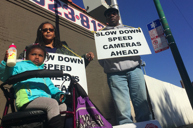 Protesters stood in the solidarity near 3200 S. Archer Ave., where the city activated a controversial speed camera Monday.
