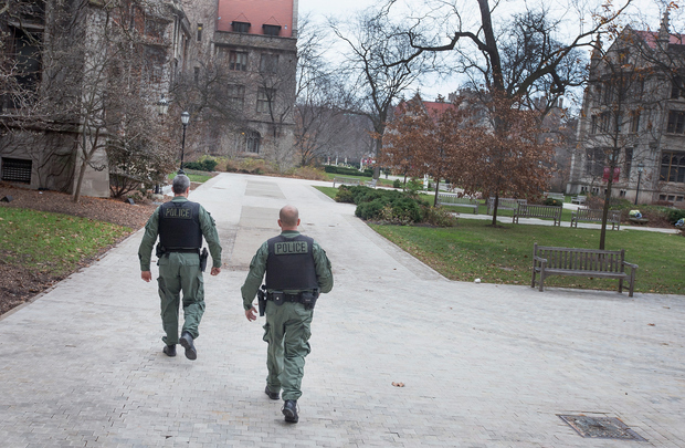 Members of the Chicago Police Department SWAT team patrol the Main Quadrangles (Quad) on the Hyde Park Campus of the University of Chicago on November 30, 2015 in Chicago, Illinois.