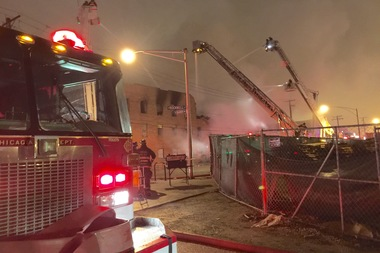 Firefighters continued to work into Tuesday morning to extinguish flames at 3057 N. Rockwell St. in Avondale, where a development including Metropolis Coffee's new roastery was undamaged.