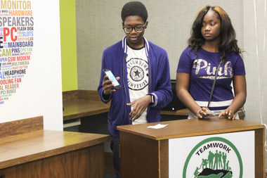 Participants of Englewood Codes, a program that teaches teens how to develop mobile apps, show their work Tuesday, Dec. 15, 2015. Tamia Creed, (r.) 16, and Joshua Moodie, (l.) 14.