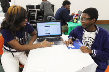 Participants of Englewood Codes, a program that teaches teens how to develop mobile apps, show their work Tuesday, Dec. 15, 2015. Tamia Creed, (l.) 16, and Joshua Moodie, (r.) 14.
