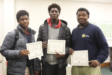 Participants of Englewood Codes, a program that teaches teens how to develop mobile apps, show their work Tuesday, Dec. 15, 2015. Charles McGraw (l.), Queon Smith (c.) and Michael Nash (r.)