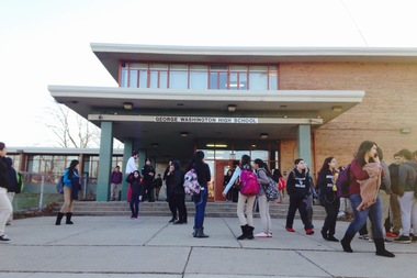 Students leave George Washington High School in East Side after staging a sit-in Friday in support of their principal.