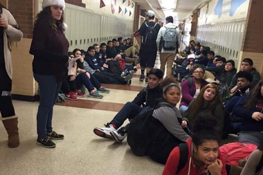 Students walked out of class Friday to support their principal, whose contract might not be extended by the Local School Council.