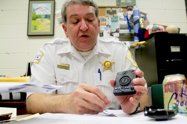 Chicago Police Cmdr. Marc Buslik explains the charging and uploading process for body cameras.